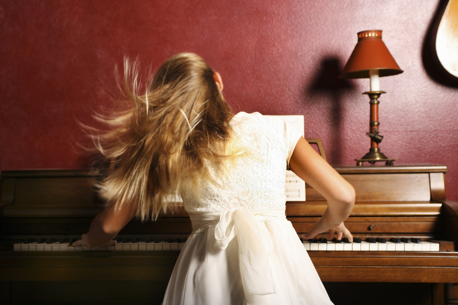 Girl Practicing the Piano